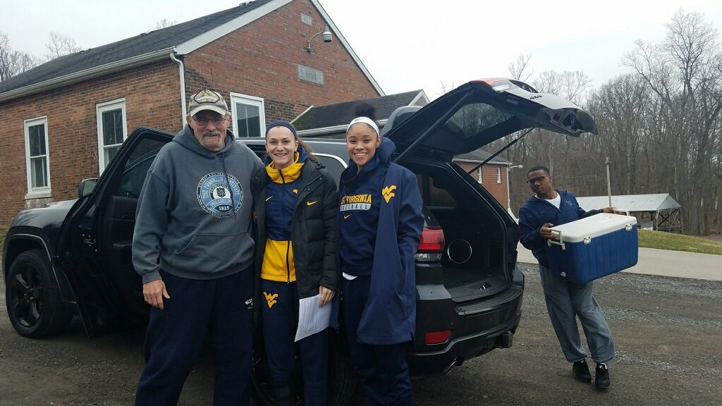WVU Women's Basketball Players volunteering as drivers